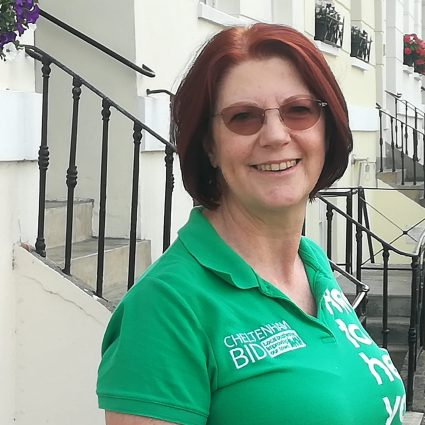 Jo-Anne Hale pictured outside The Logical Ultilities Company in BID green polo shirt with Cheltenham BID logo.